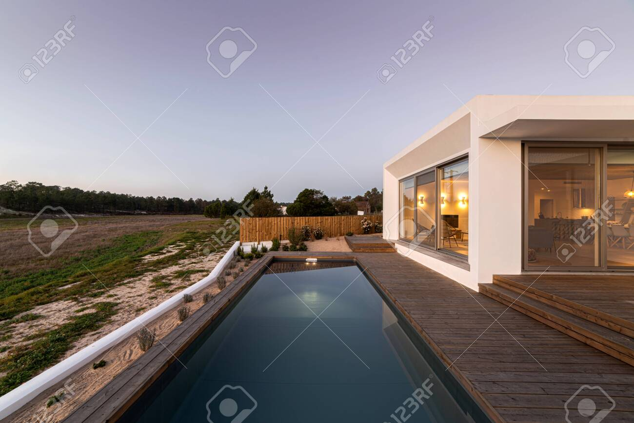 Swimming Pool With Wooden Deck View On Modern Villa Stock Photo Picture And Royalty Free Image Image 141658046