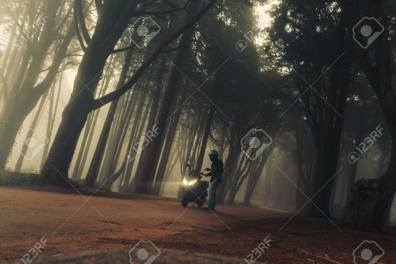 A motorcycle in the mystical fog of the Sintra forest, Portugal - 158719096