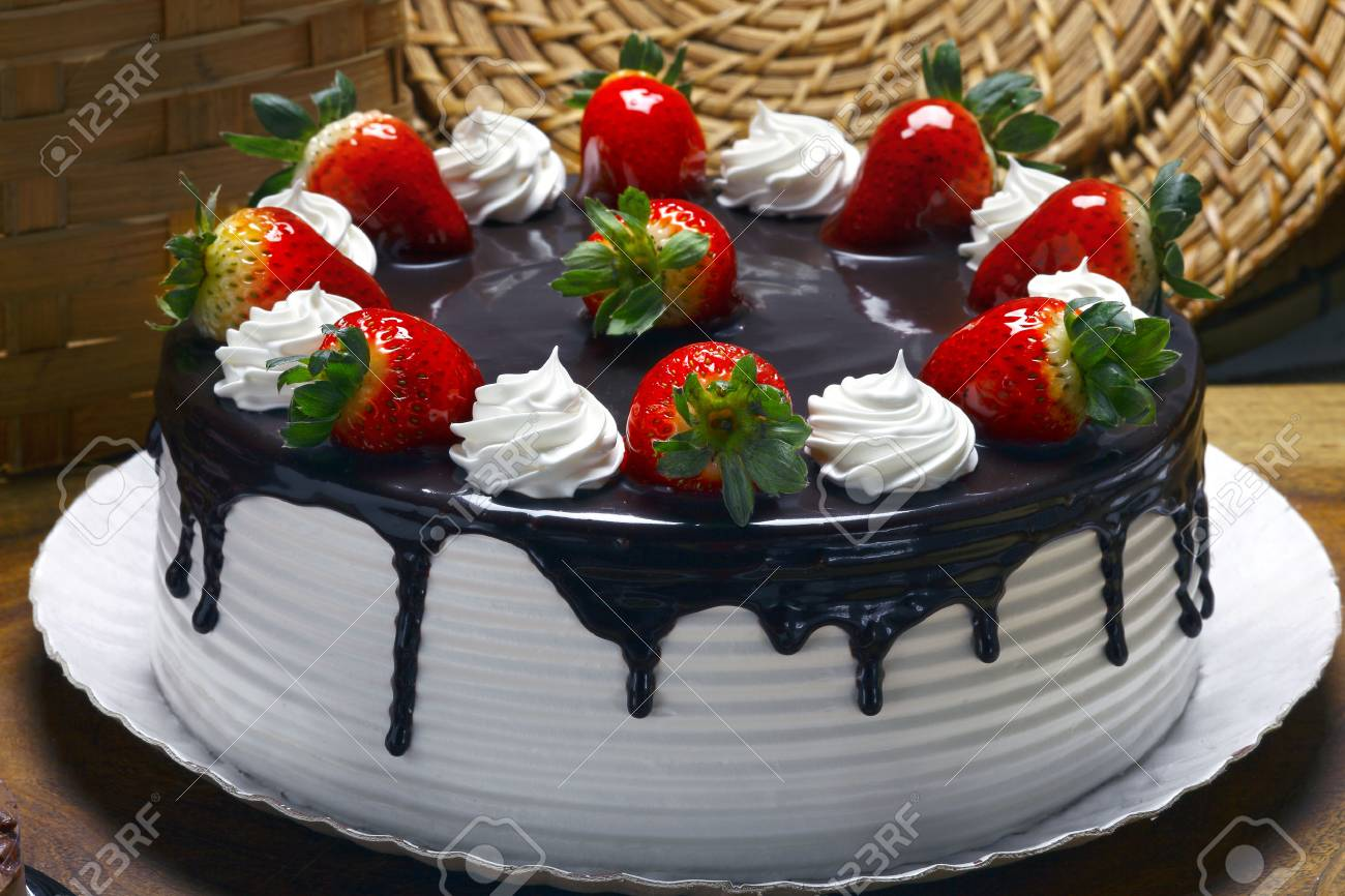 Marvelous Strawberry Birthday Cake With Whipped Cream And Chocolate Stock Funny Birthday Cards Online Elaedamsfinfo