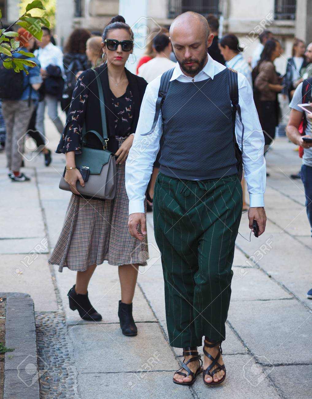 201c7d341ad MILAN - SEPTEMBER 21  Excited man walking after VIVETTA fashion show