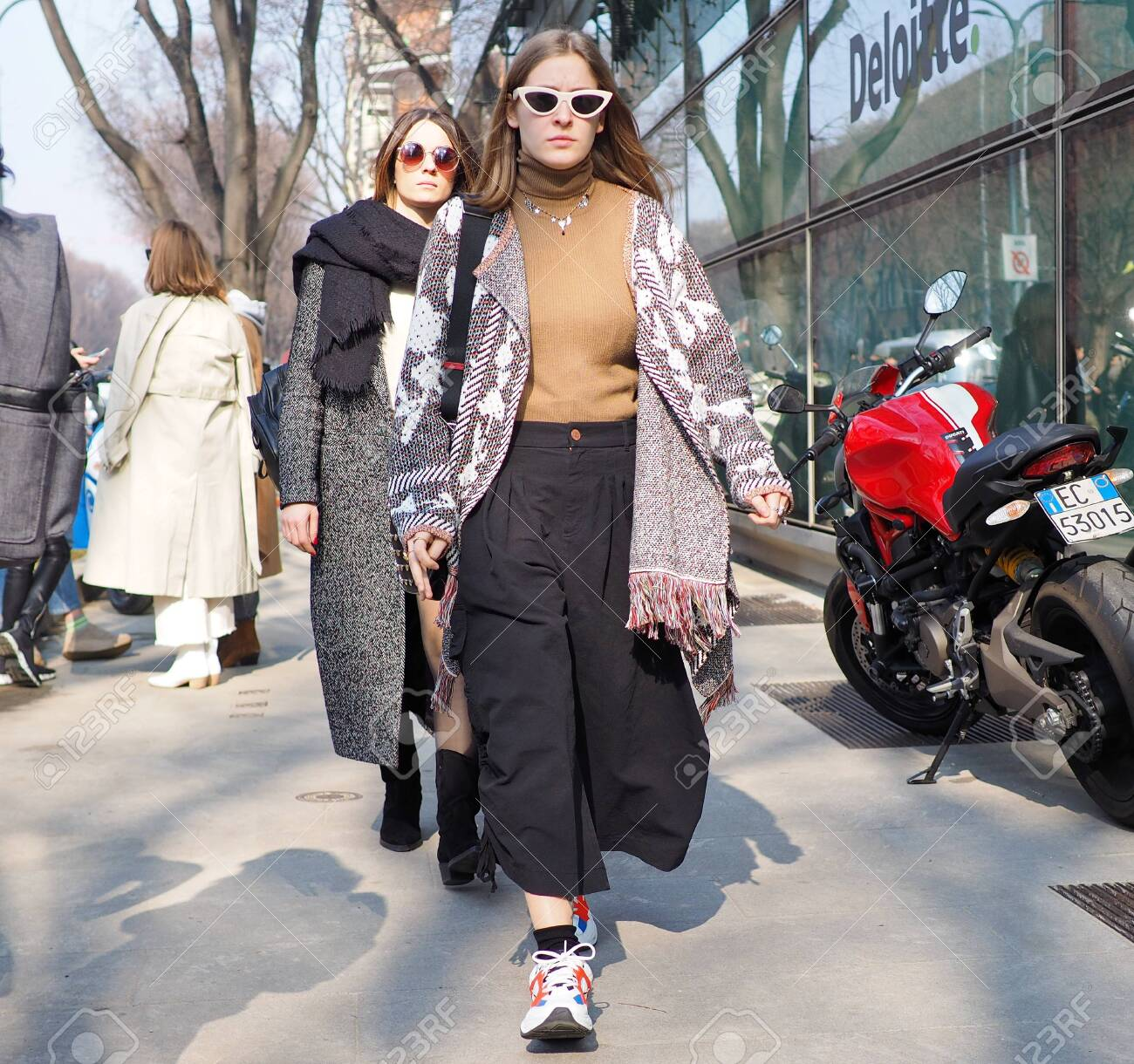MILAN, Italy February 21, 2019 Fashion blogges street style..