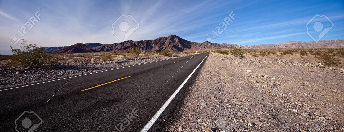 Long road in Death Valley National Park, California. Death Valley is a desert valley located in Eastern California. Stock Photo - 9946264