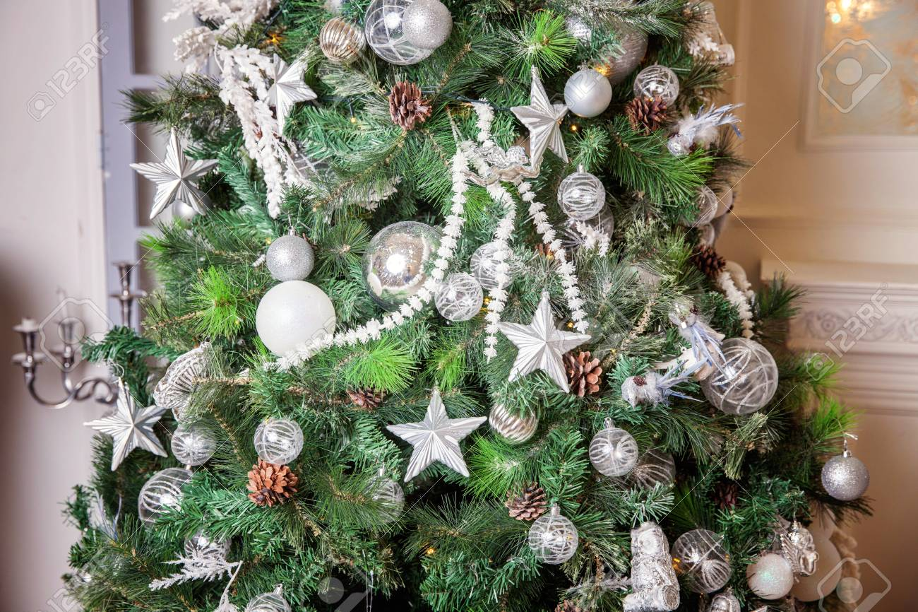 Christmas tree with white and silver decorations stock photo