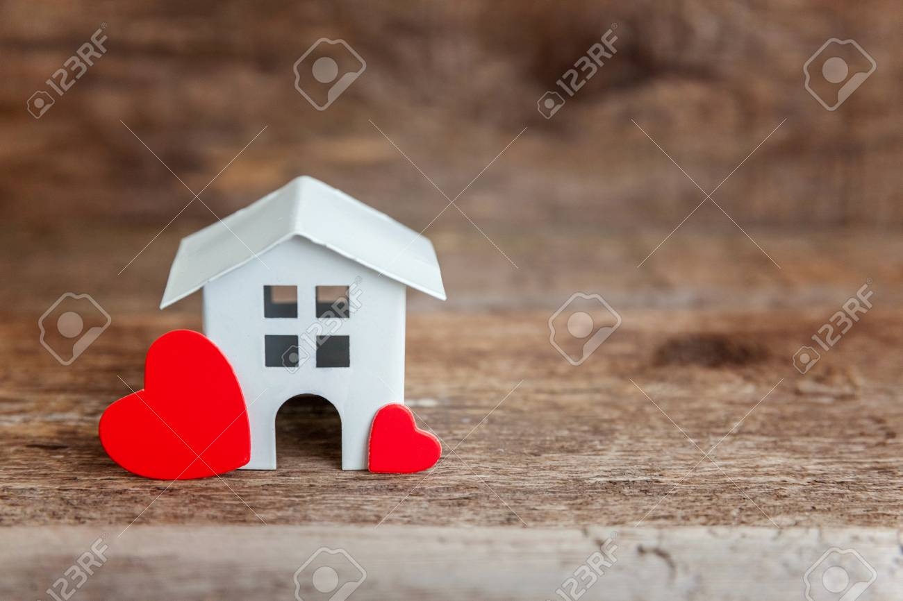 Miniature White Toy House With Red Hearts On A Wooden Table... Stock ...