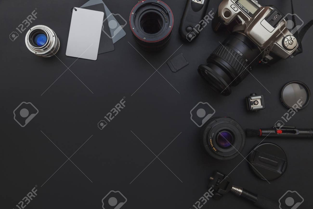 Photographer workplace with dslr camera system, camera cleaning kit, lens and camera accessory on dark black table background. Hobby travel photography concept. Flat lay top view copy space - 120872969