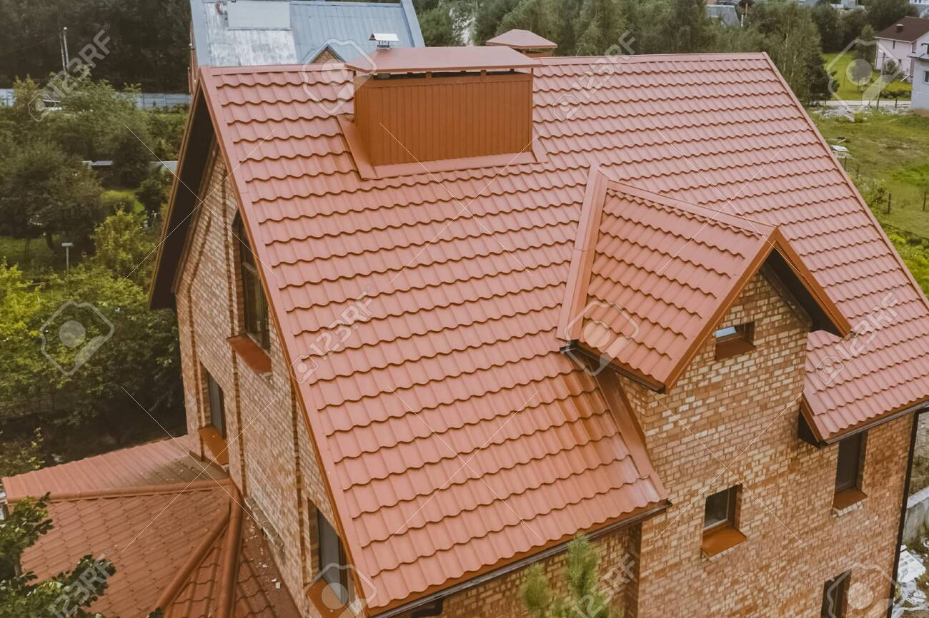 Modern Roof Made Of Metal. Corrugated Metal Roof And Metal Roofing... Stock  Photo, Picture And Royalty Free Image. Image 137597901.
