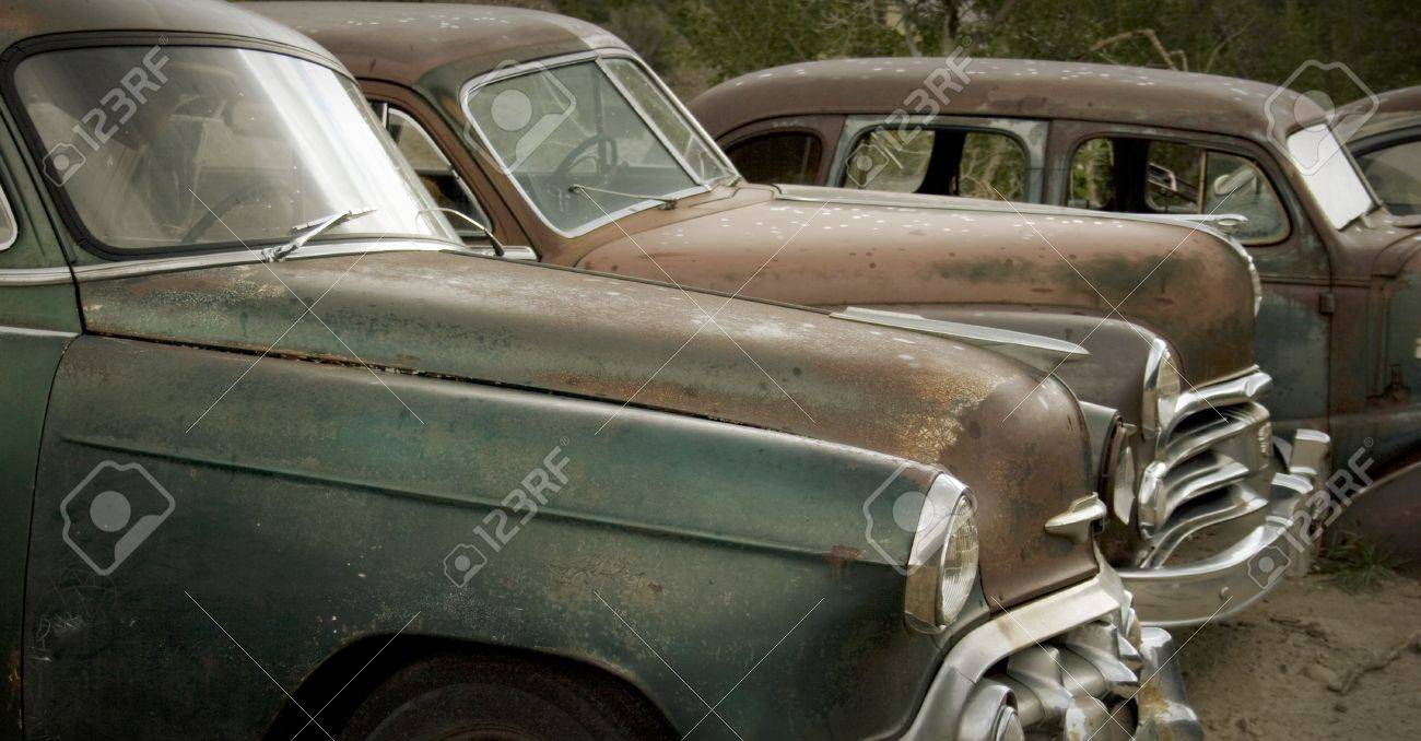 Old Rusted Cars In The Rain At The Junkyard Looking Sad. Good ...