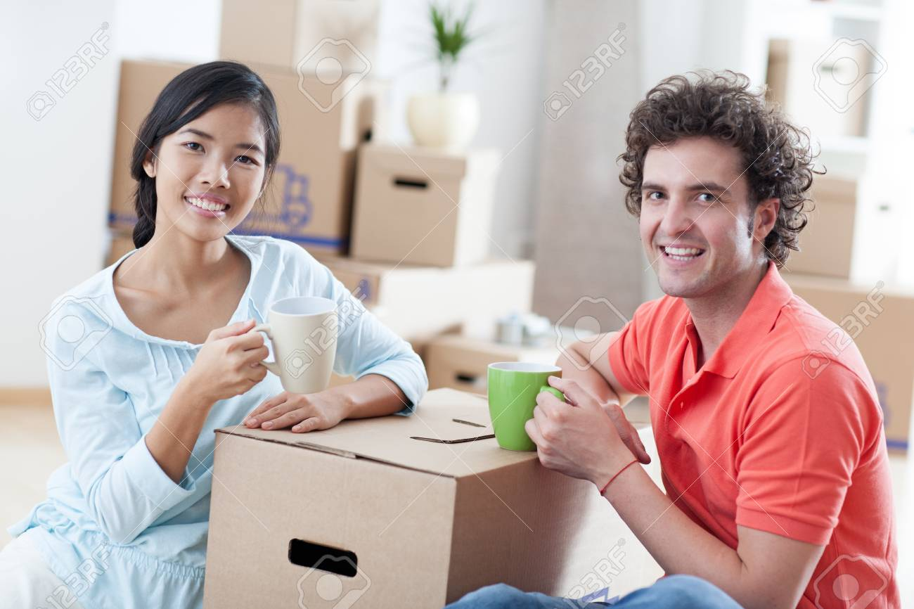 Happy couple moving into a new apartment Stock Photo - 19123362