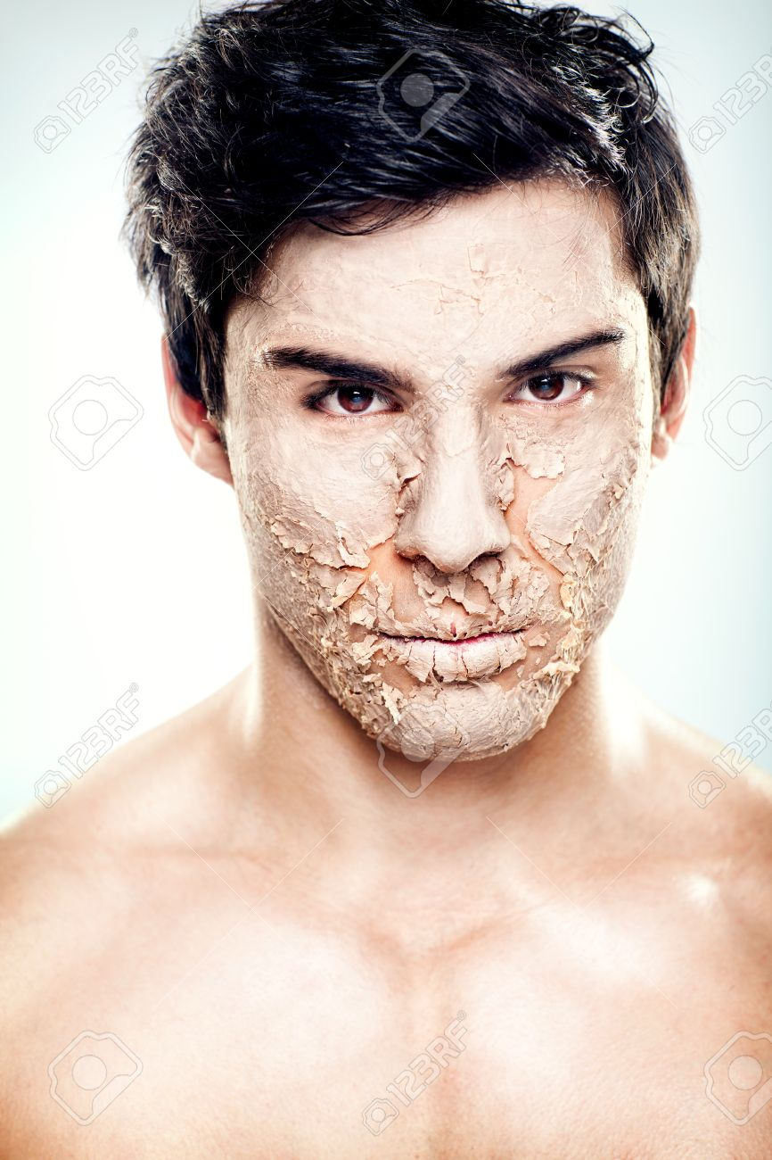 a handsome male model with the skin his face peeling stock photo