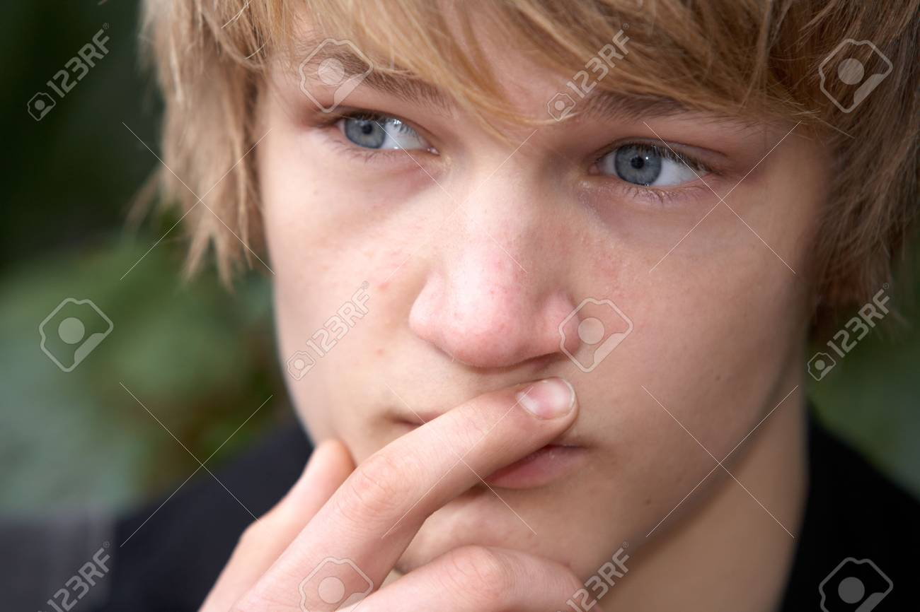 Teenage boy contemplating in city park, close-up Stock Photo - 3448095