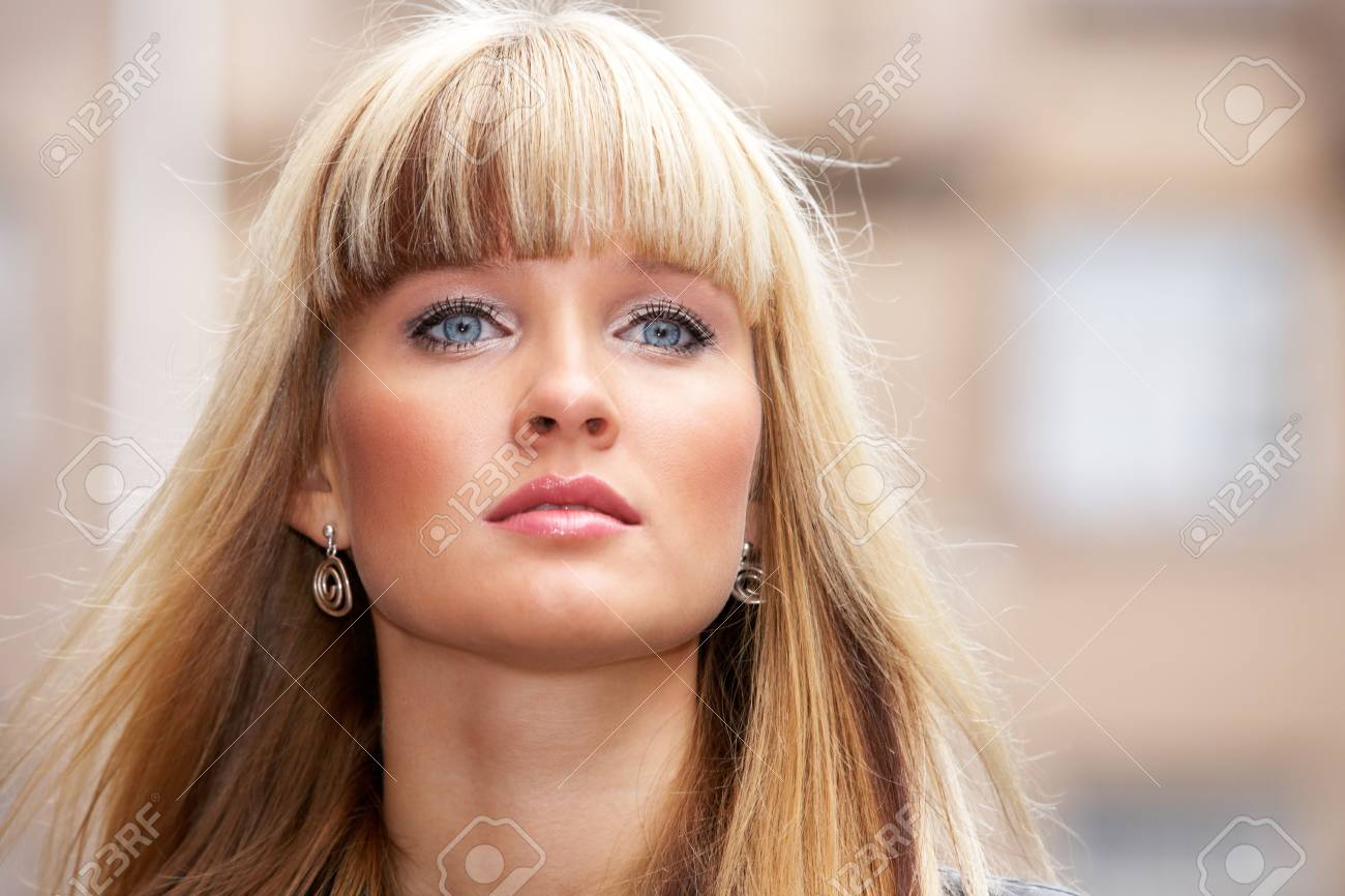 Close-up of young woman standing in city, looking away Stock Photo - 3466086