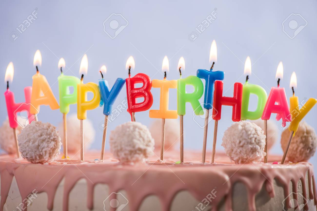 Stupendous Lit Happy Birthday Candles On Top Of Pink Birthday Cake Stock Funny Birthday Cards Online Elaedamsfinfo