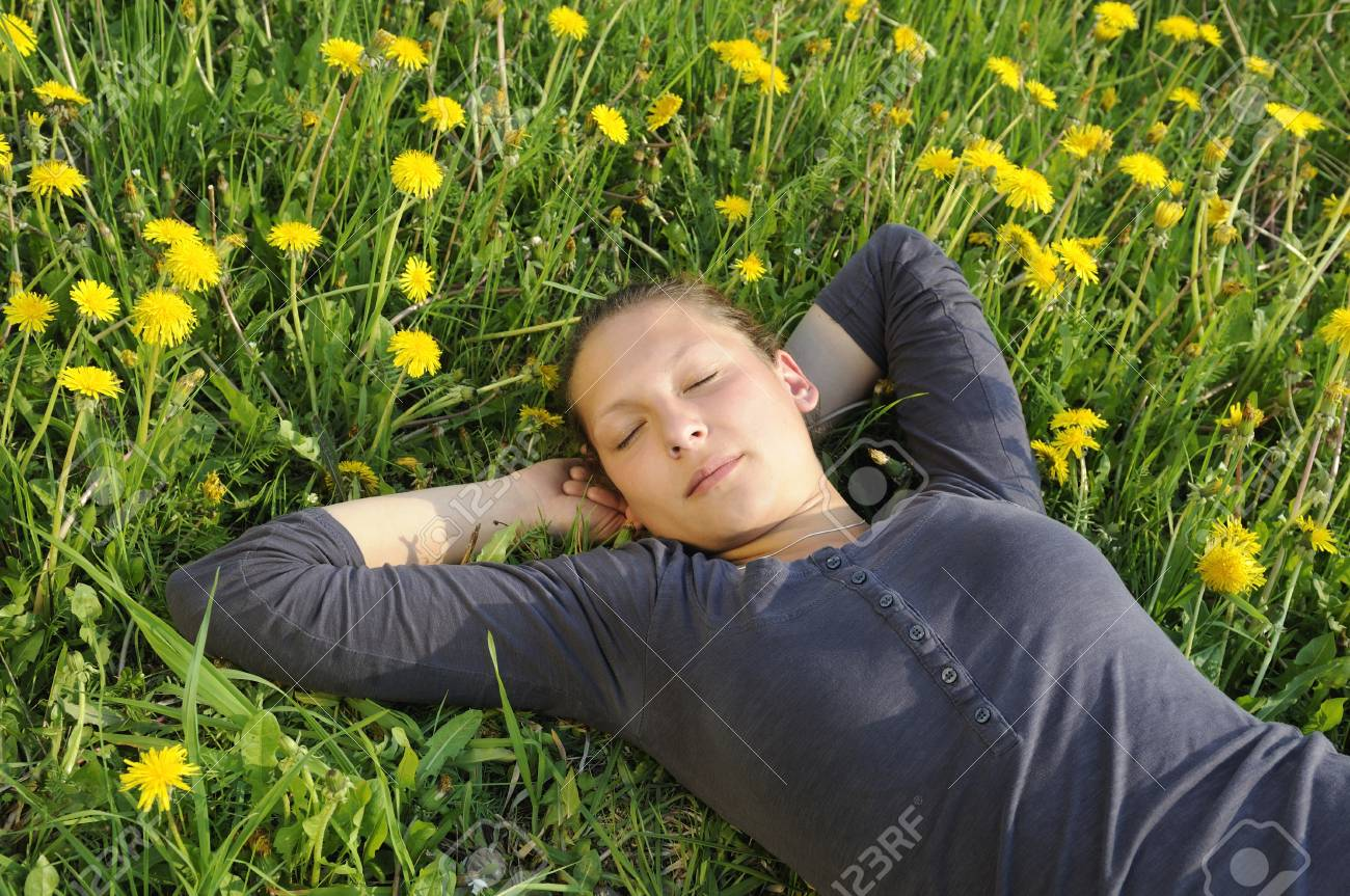 young woman lies on a flower meadow Stock Photo - 9519175