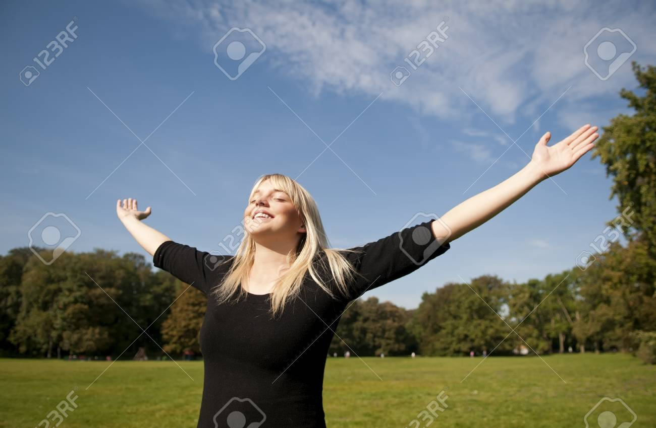 young woman spreads her arms Stock Photo - 10978750