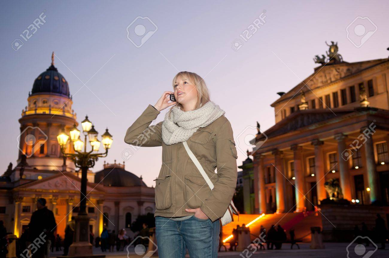 young woman phoned in the city at evening Stock Photo - 11281942