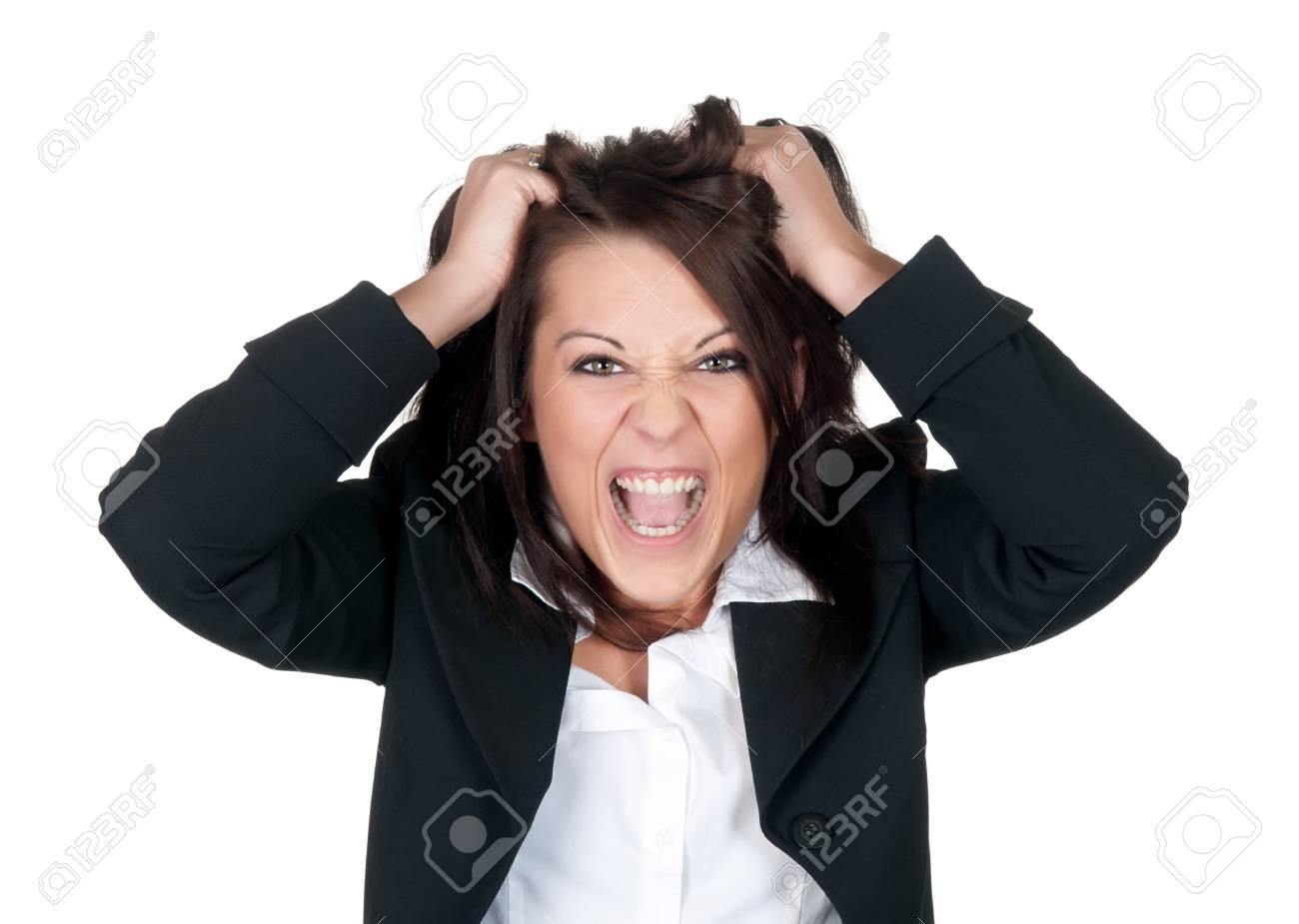 stressed businesswoman ruffles her hair Stock Photo - 12580314