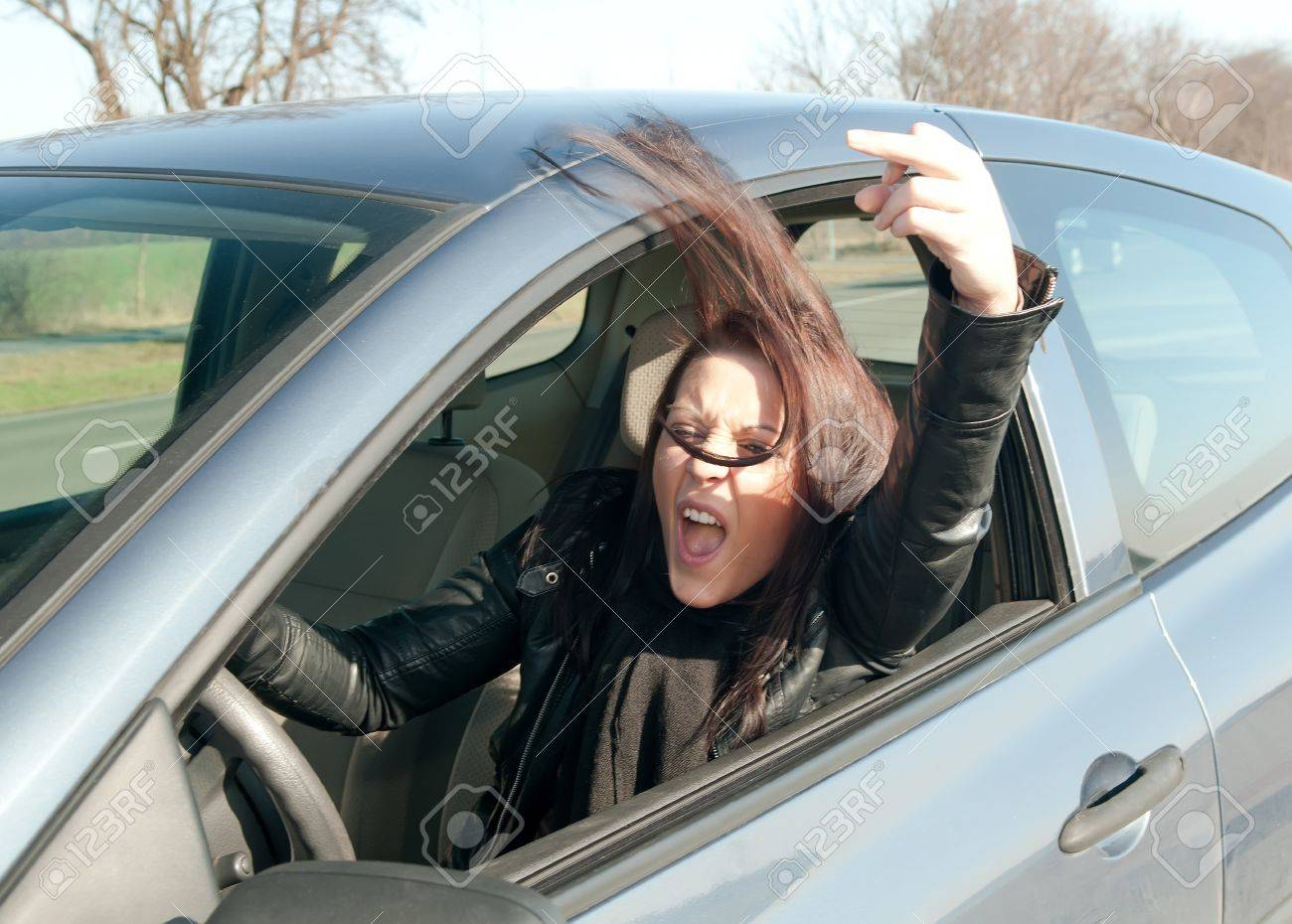 angry young woman in the car shows the middle finger Stock Photo - 13327104