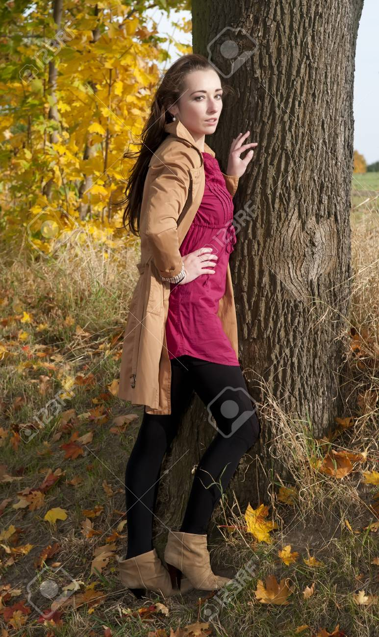 thoughtful young woman stands on a tree Stock Photo - 16590251