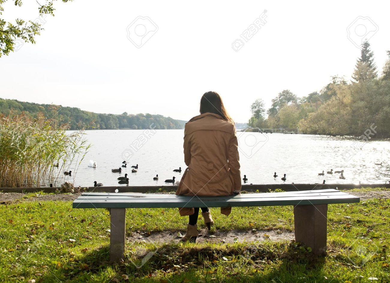 lonely young woman on lake, rear view - 16590151