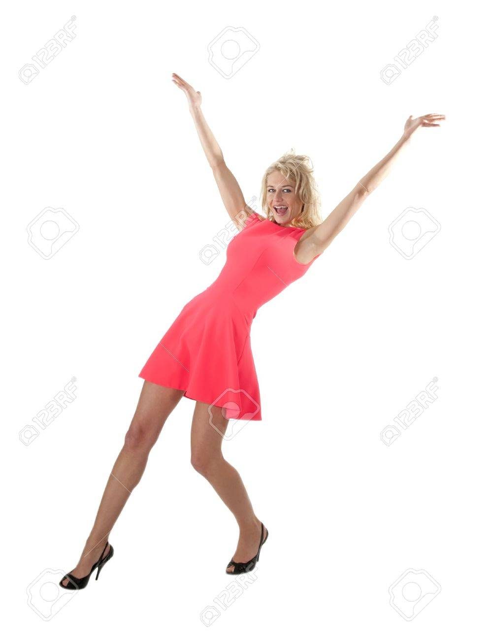 happy young woman in red dress cheering with raised arms Stock Photo - 20047446