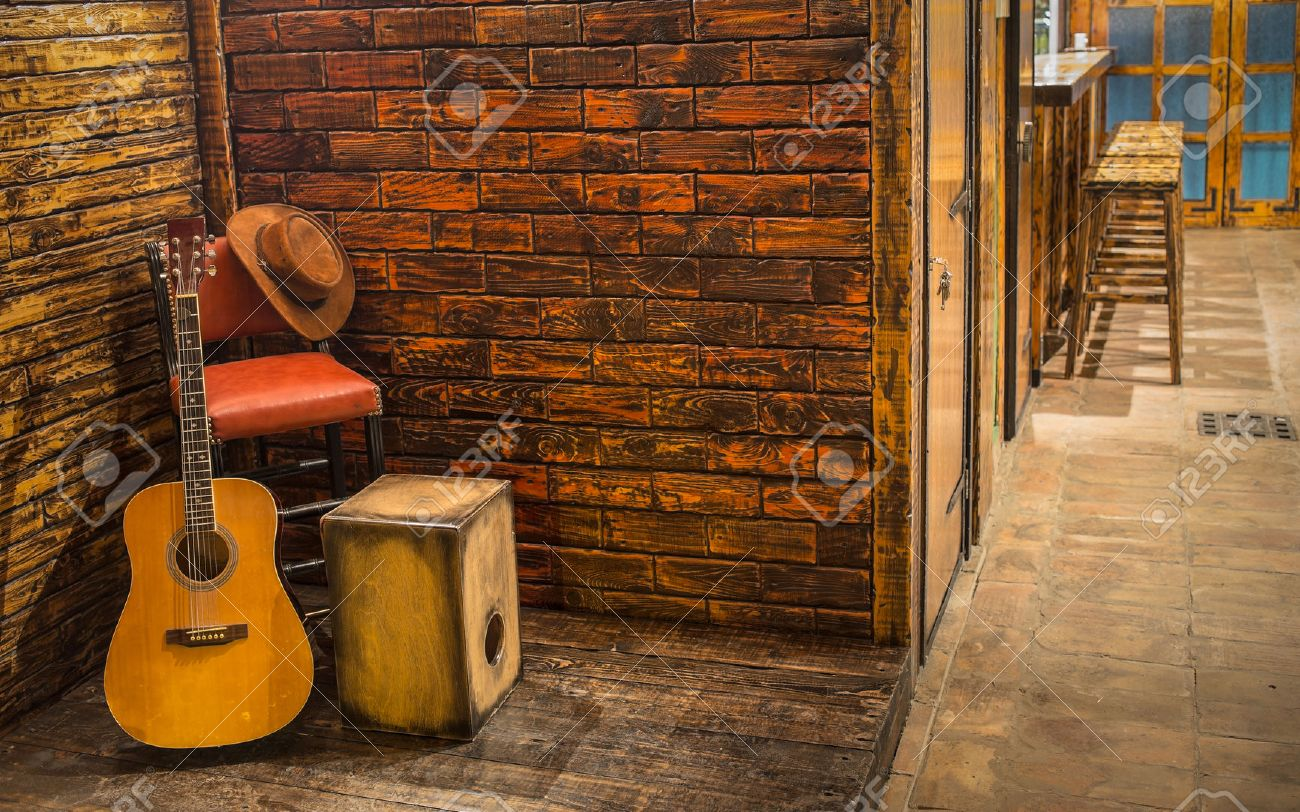 Music instruments on wooden stage in pub - 46417483