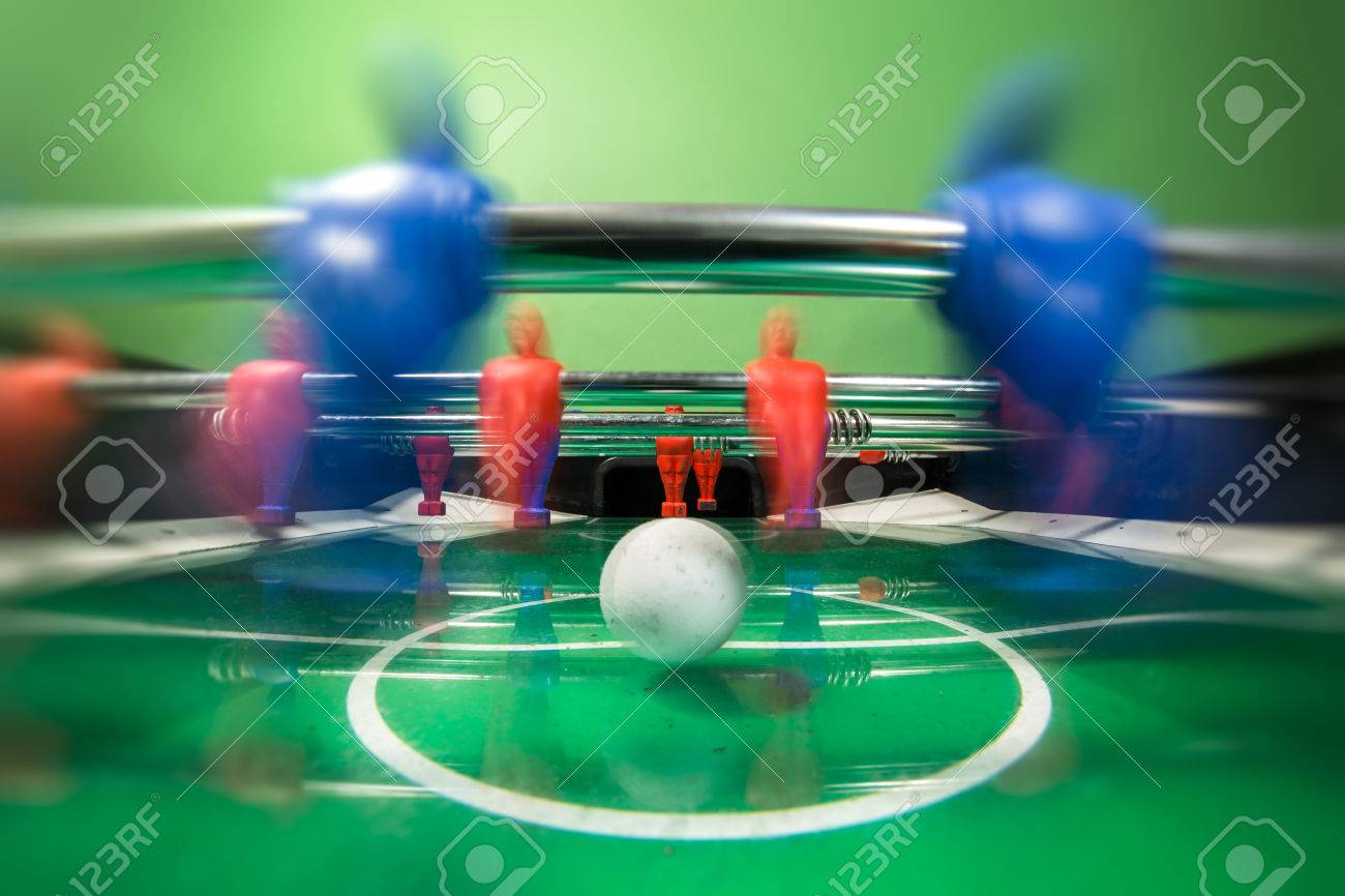 Soccer table game with red and blue players - 82980816