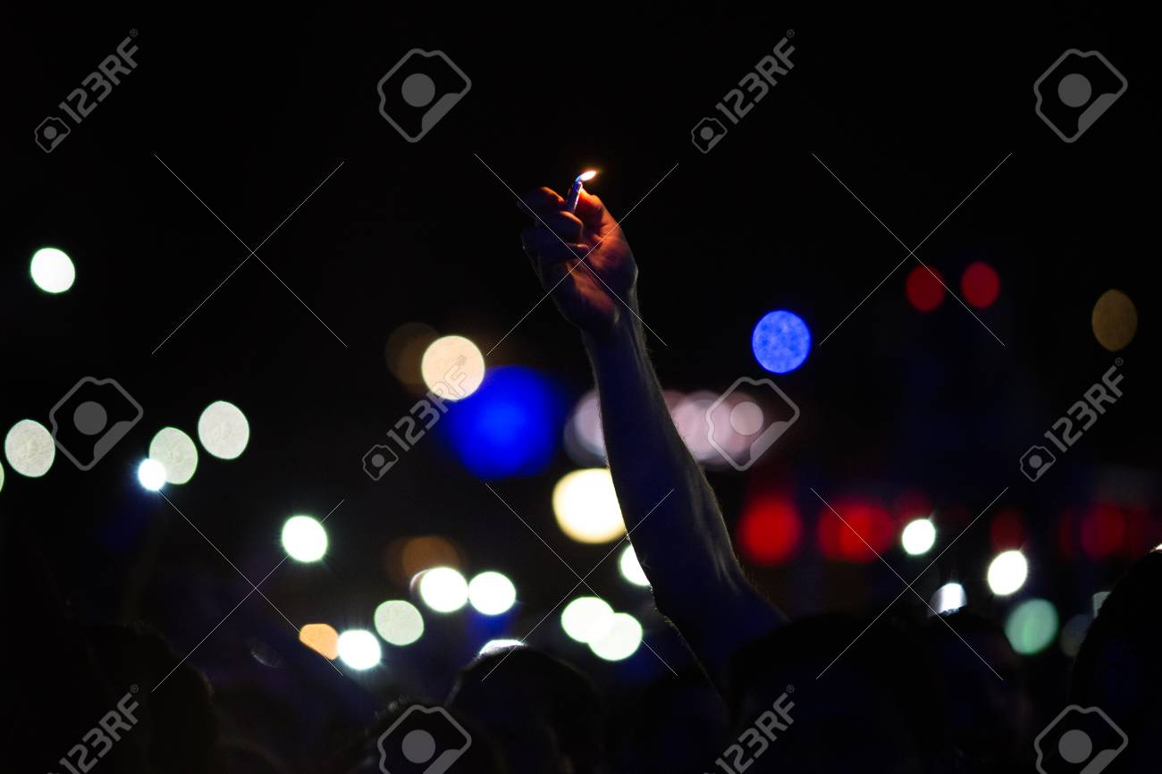 Romance on the concert, lighter in the hand - 106357404
