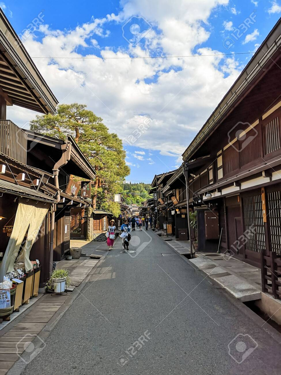 City center of the old traditional Japanese mountain town Takayama in Gifu prefecture with authentic wooden buildings - 137495732