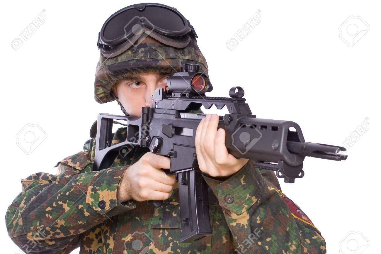 one soldier with the gun in the hands on a white background - 4249752