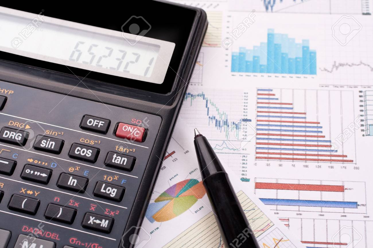 financial statement with calculator and pen - 4912787