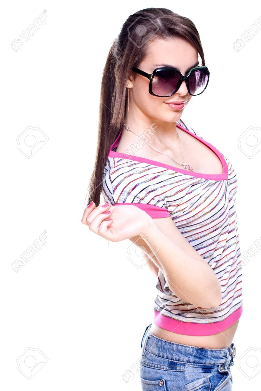 woman in a pink shirt with the glasses on a white background - 4932492