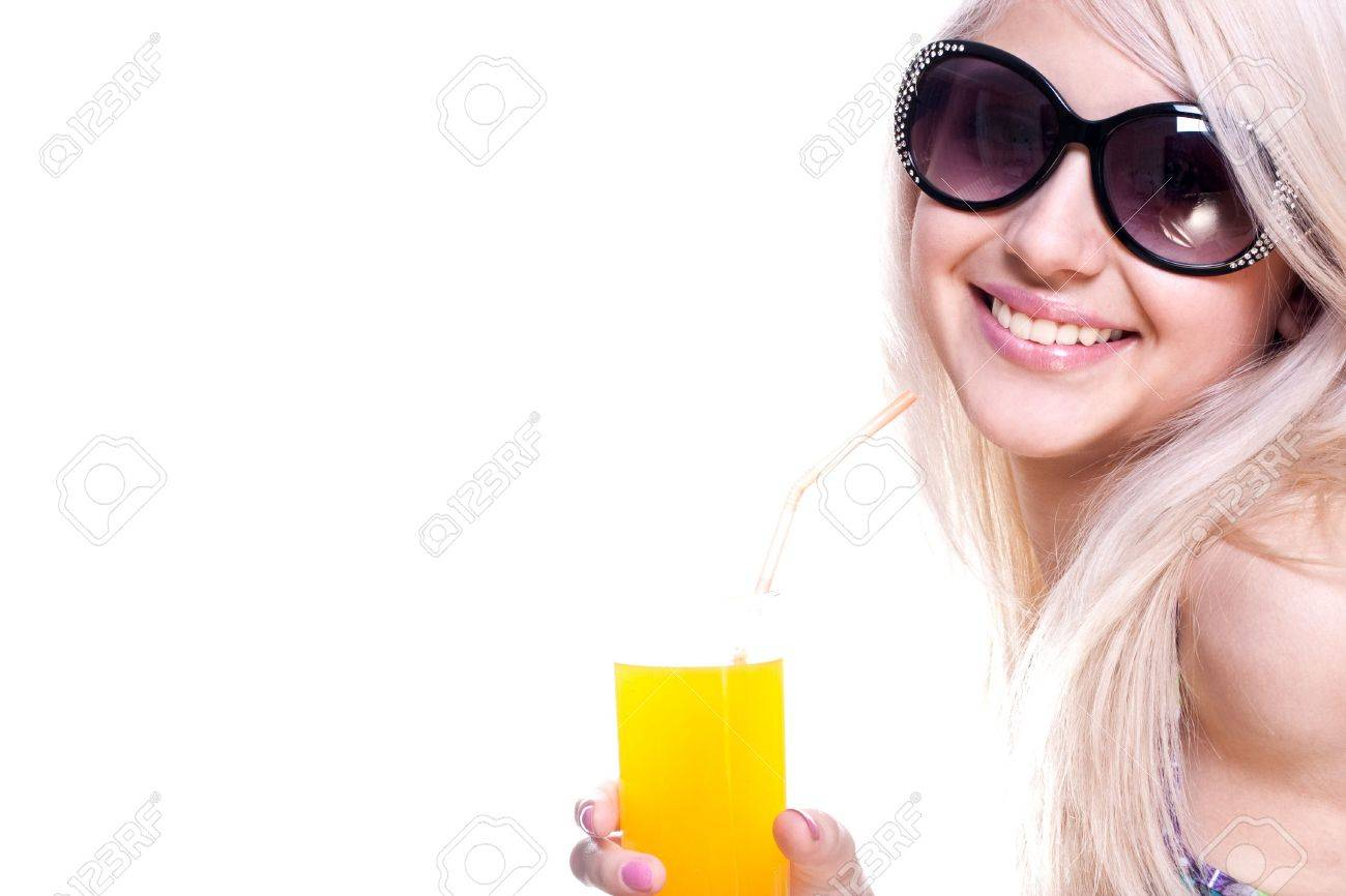 beautiful women in swimsuit with a glass of juice on a white background isolated - 5014660