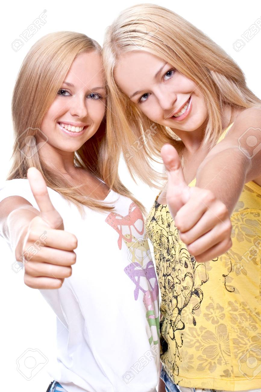 two beautiful women giving thumbs-up on a white background - 5258677