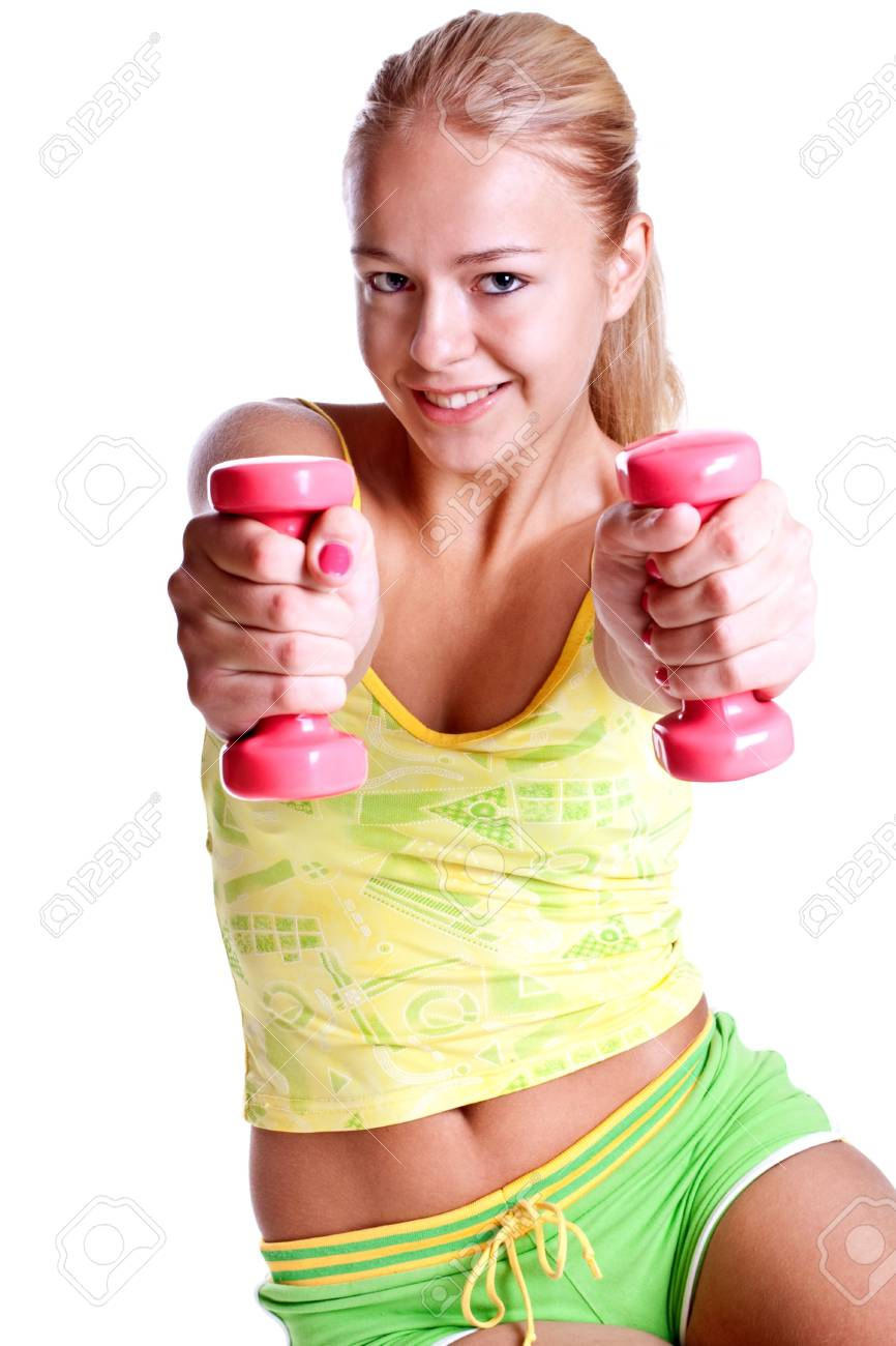 pink dumbbells in the hands of women on a white background - 5679048