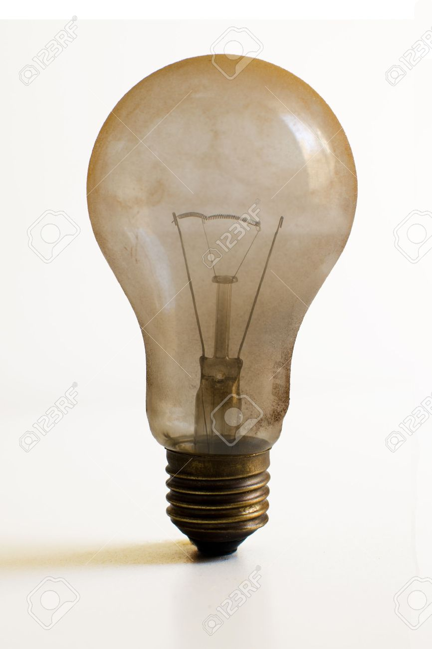 Old technology and wasting electricity, burned out light bulb Stock Photo - 9897972