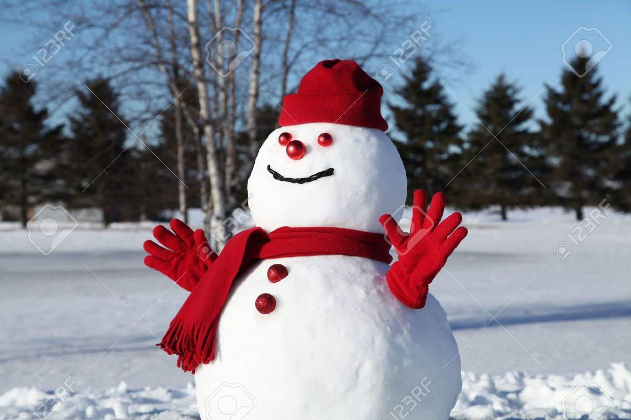 Snowman in his red outfit on a beautiful and cold January morning. Stock Photo - 12151264