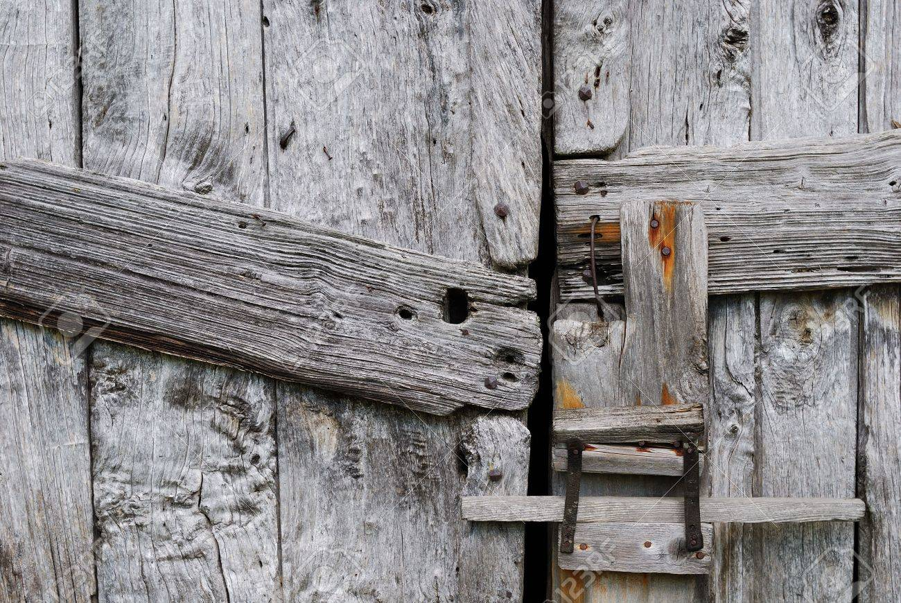 Barn door latches - Close View Of A Barn Door And Latch Stock Photo 2196990