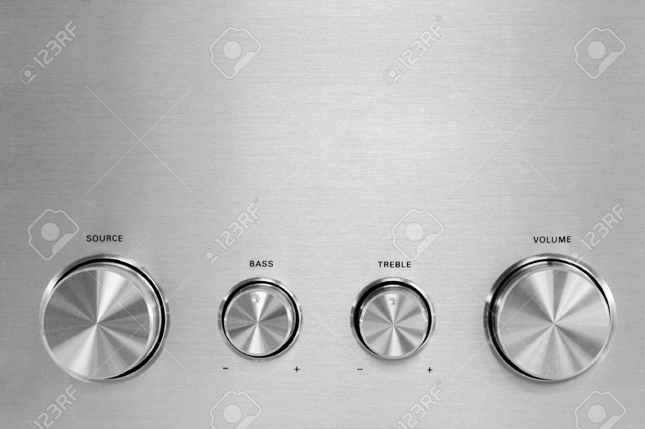 Four isolated gray hifi knobs from a stereo amplifier Stock Photo - 4807085