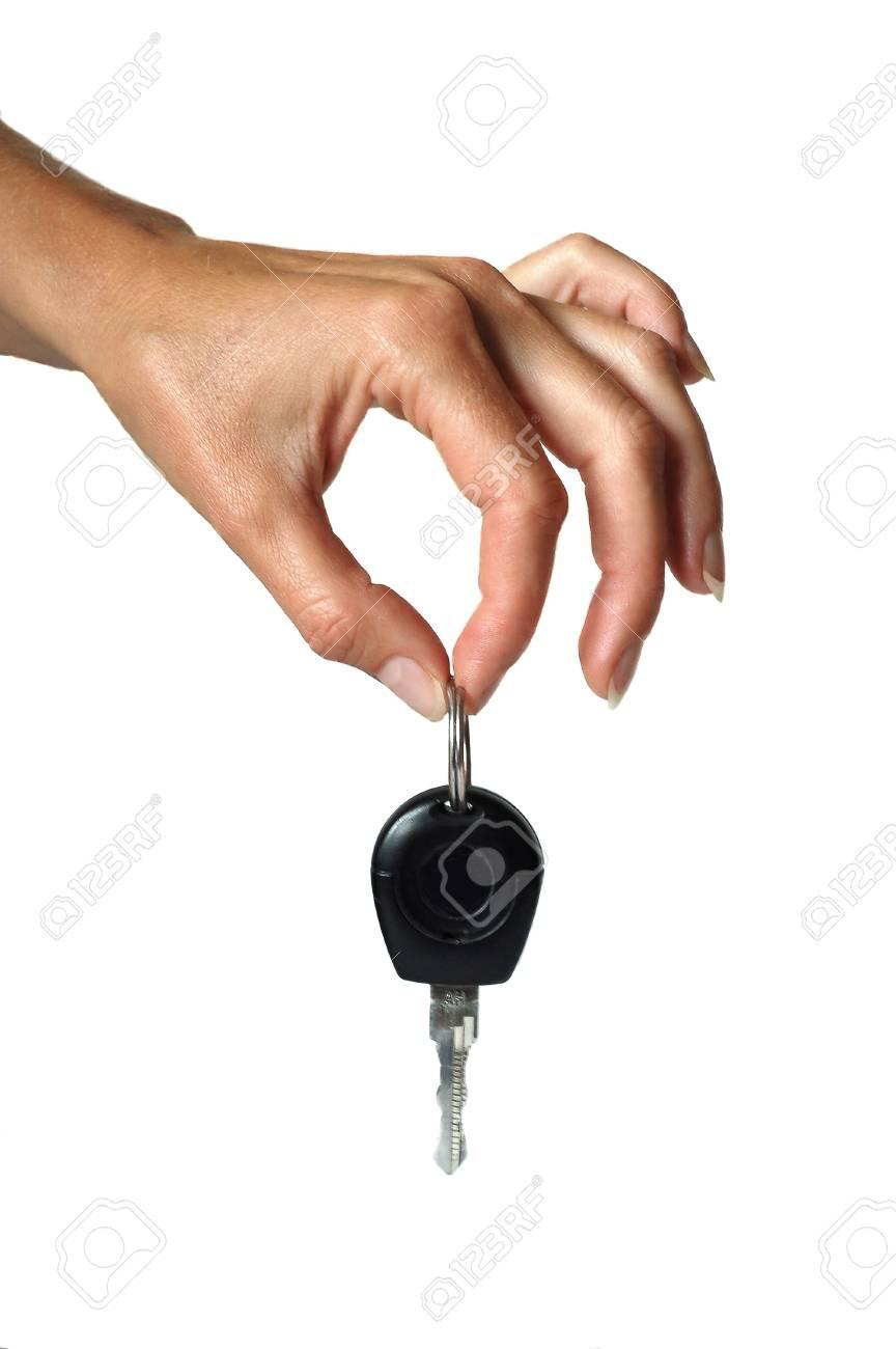 hand holding metallic key  isolated Stock Photo - 16927586