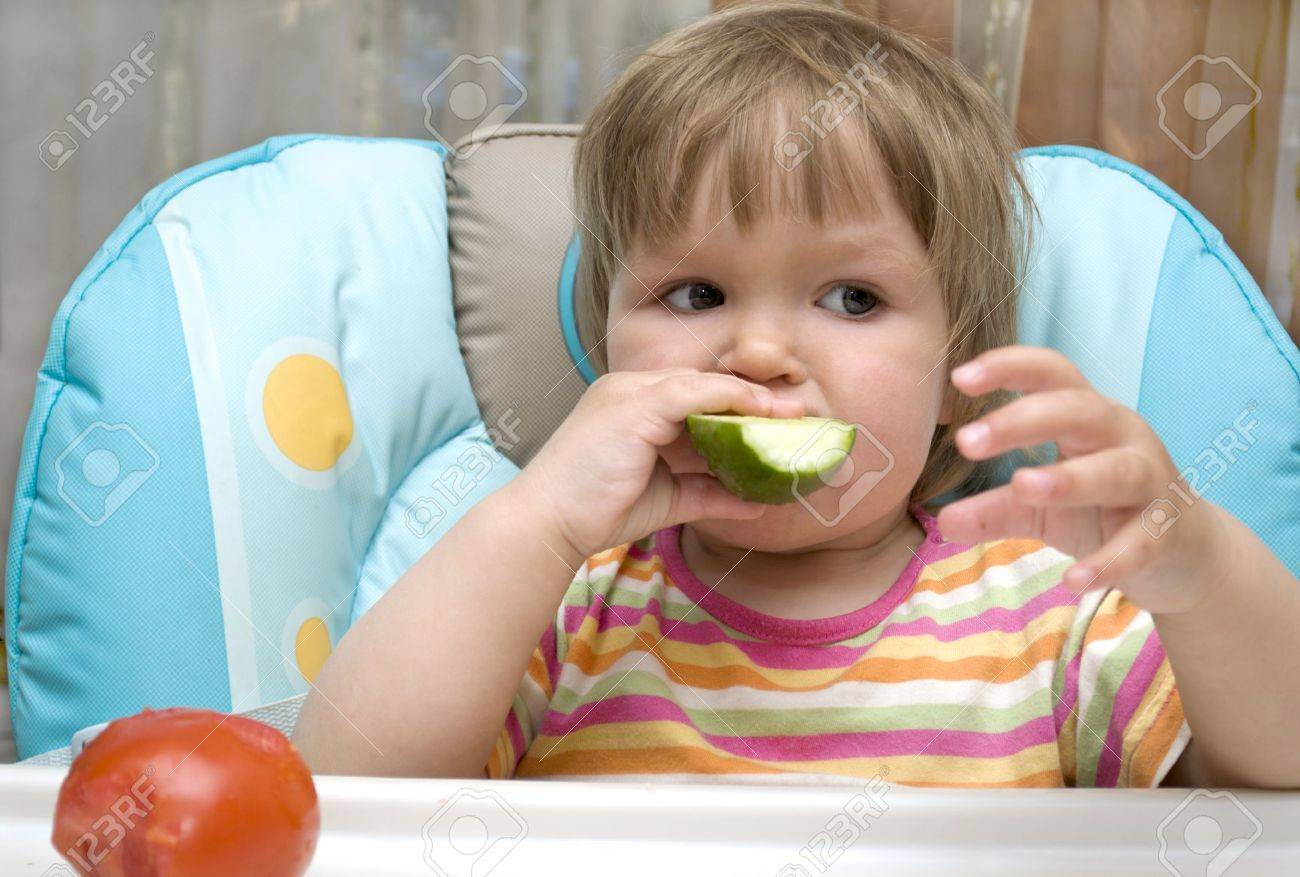 The kid is bite off a cucumber Stock Photo - 10562204