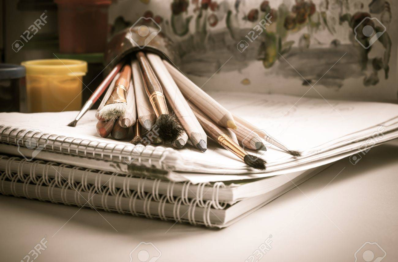 Colored pencils, paint, sketch pad, drawing, brush Stock Photo - 16393749