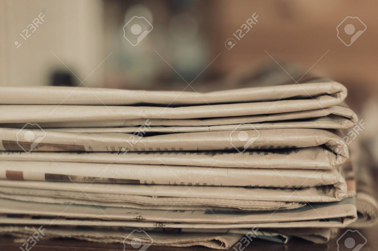 stack of old newspapers - 42939496