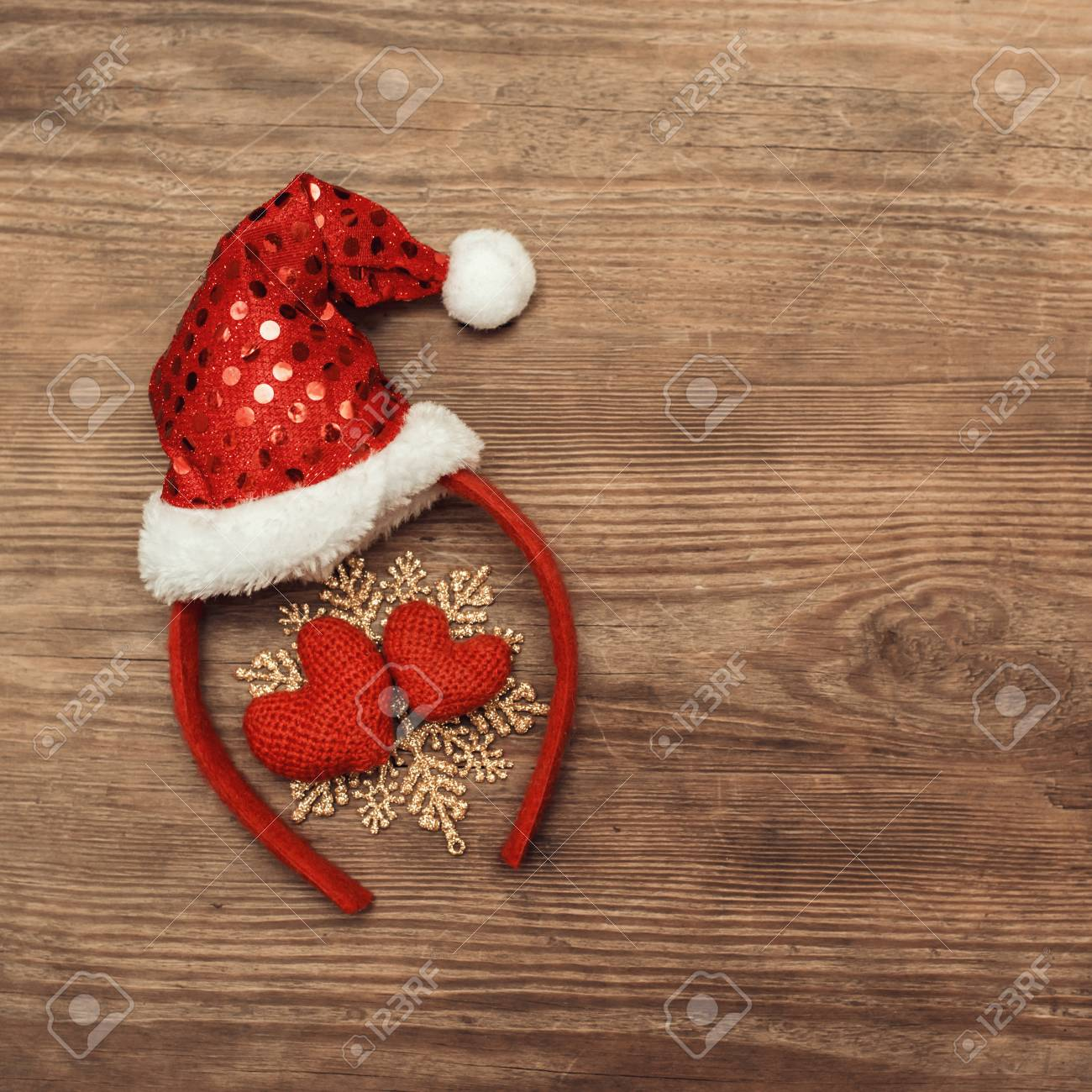 Christmas background with christmas decoration with a red cap of Santa Claus  and two hearts on 37f7386c828d