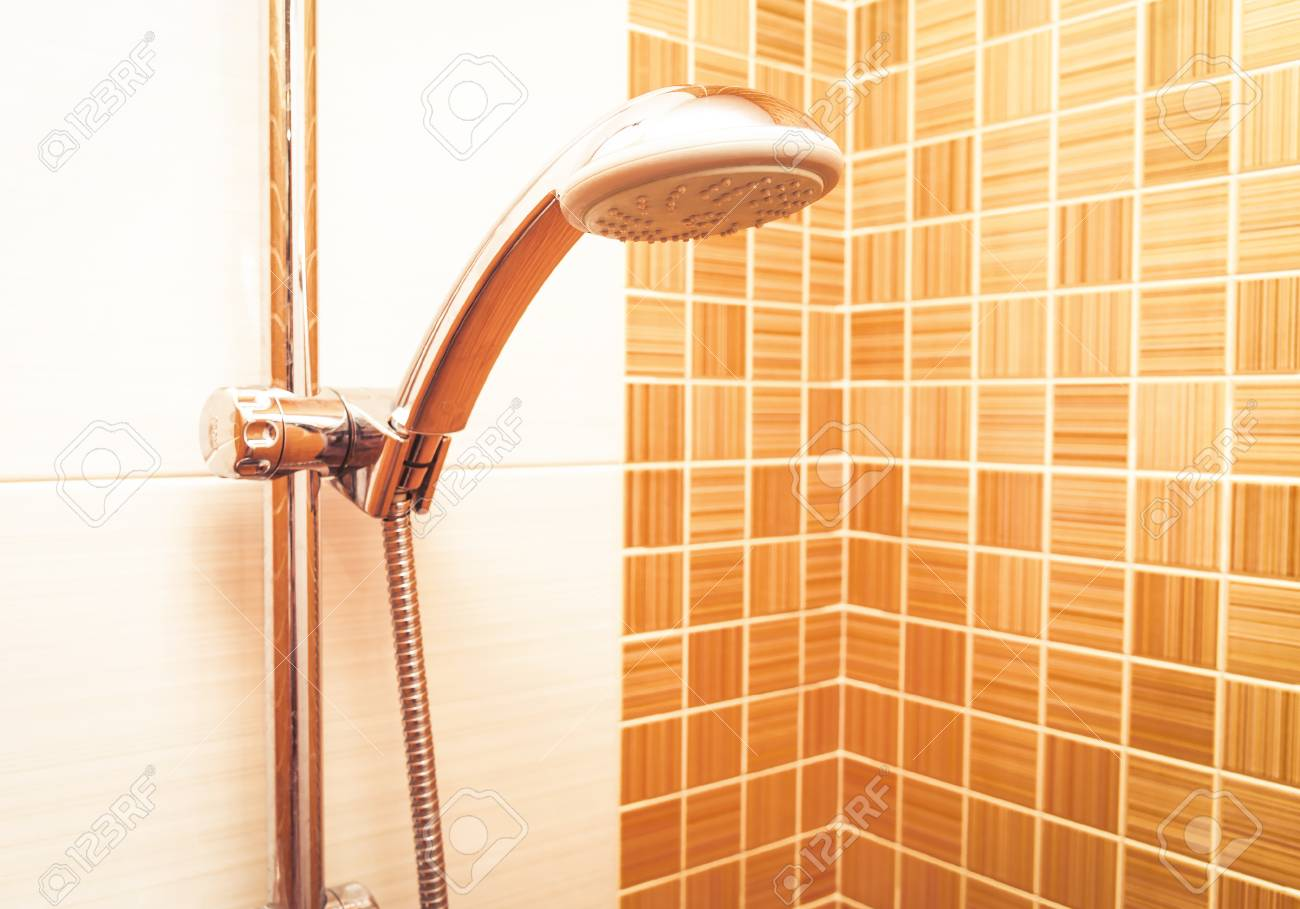 Closeup Of A Height Adjustable Shower Head In Modern Bathroom