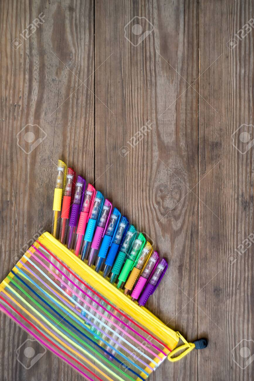 Set of multicolored gel pens on wooden background. School concept. Copy space. - 121366298