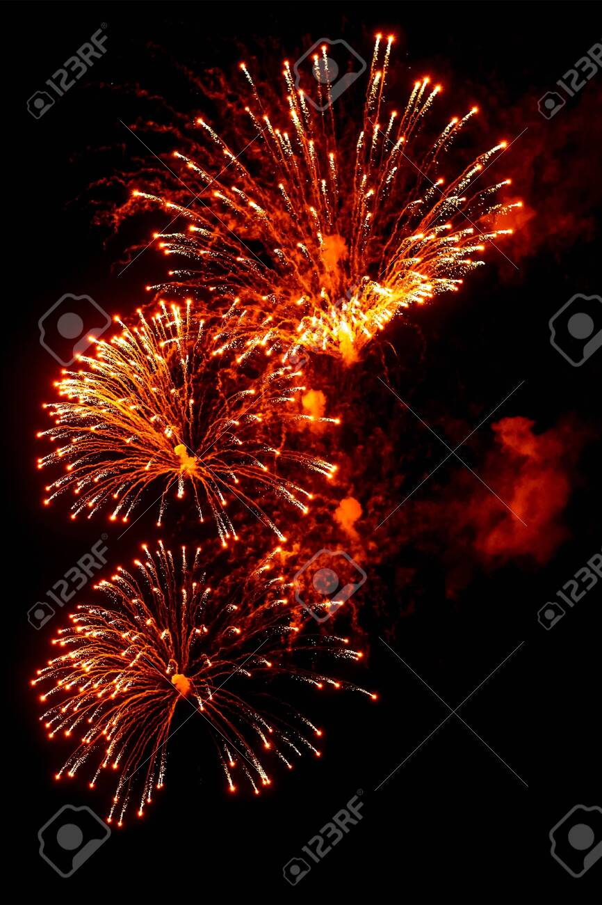 Close-up red and gold festive fireworks on a black background. Abstract holiday background - 135797486