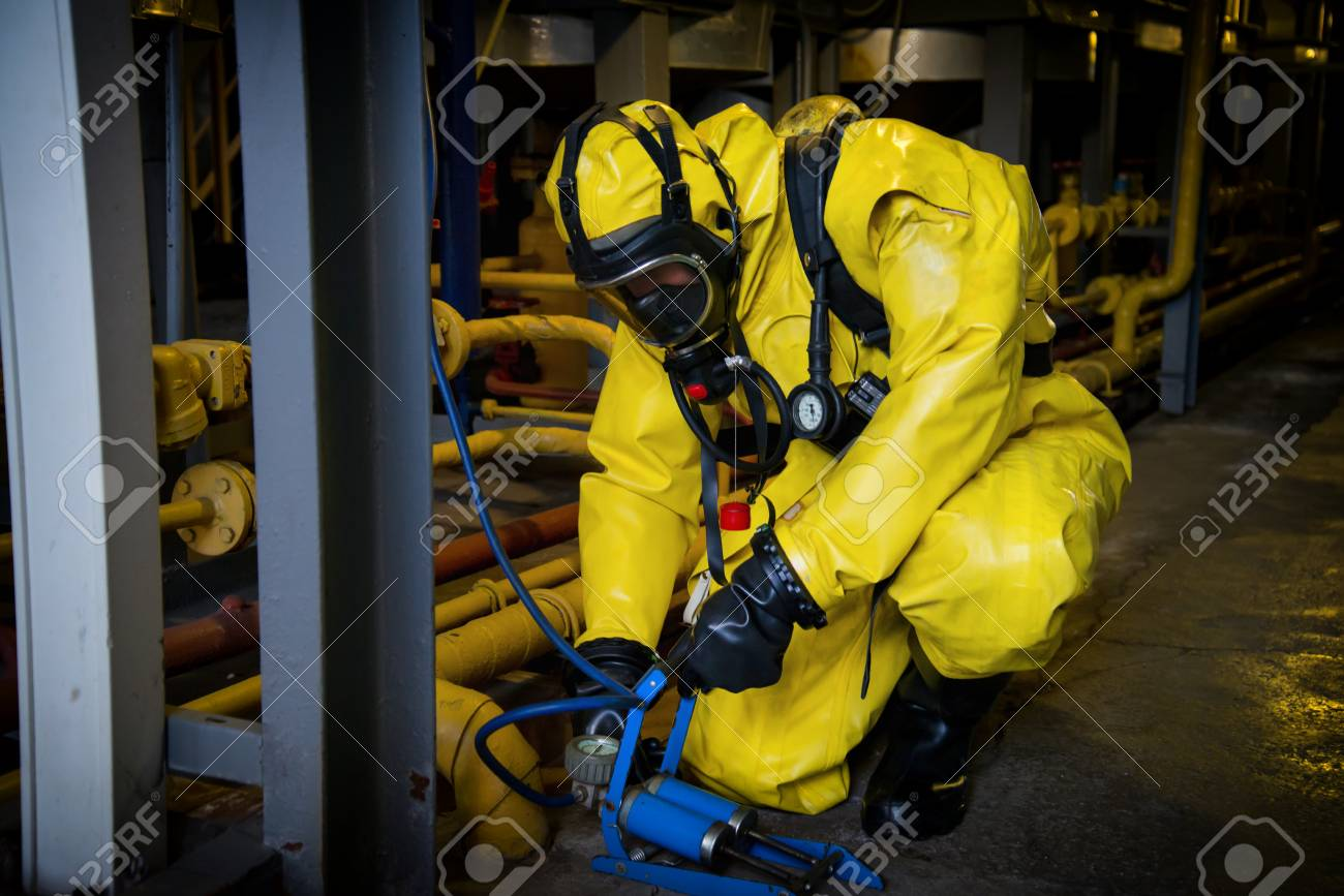 Rescuers in a radiation protection suit. - 119154322