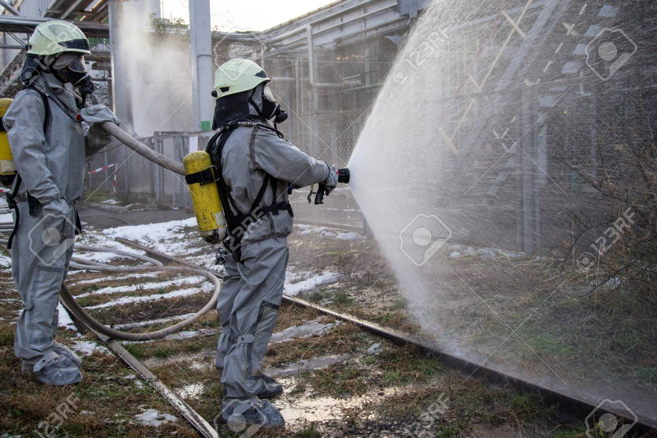 Firefighters in chemical protection suit. - 119156079