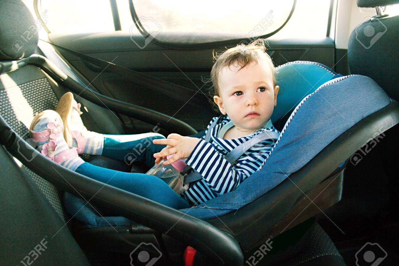 Baby Smile In A Safety Car Seat Security One Year Old Child Girl In