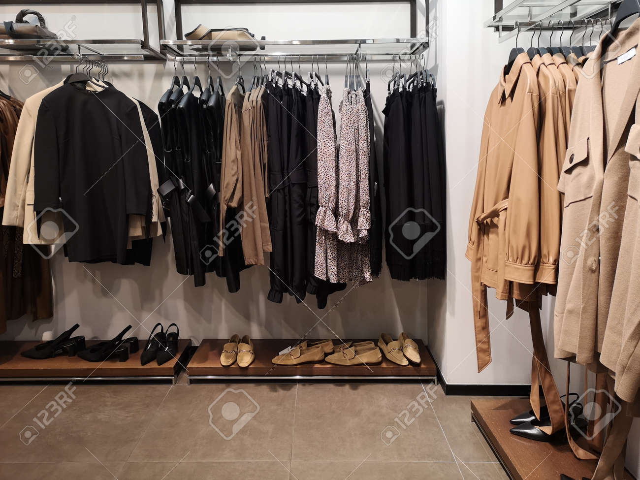 Row of clothes garment spring, autumn and winter woman fashion collection - 157428806